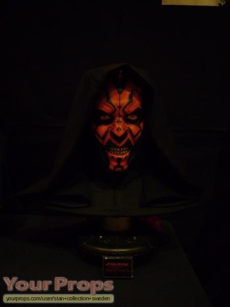 Star wars the phantom menace darth maul statue with a shelf full